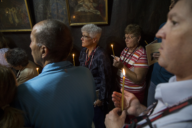 20_Holding Candles in the Grotto.jpg